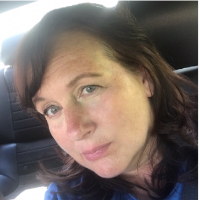This is Catherine Woods's avatar and link to their profile