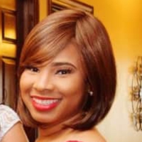 This is Tenisha Johnson's avatar and link to their profile